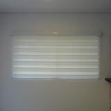 colocação de cortina rolo na sala Parque Novo Mundo